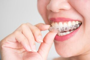 young woman learning that Invisalign® Can Improve Your Smile Discreetly