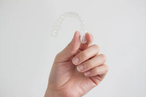 a clear tray that will help with the positive effects and benefits of Invisalign®